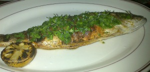 The signature dish of the restaurant the oven-roasted whole branzino (a European seabass shipped fresh to the restaurant) with the best salsa verde and arugula and filleted tableside with us as spectators.