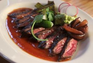 Split La Luna's delicious carne asada with chile de arbol sauce, sauteed veggies, and a gordita de pastor and...