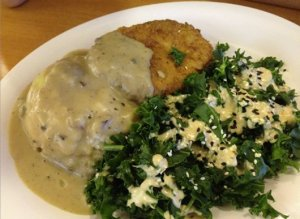 The Veggie Grill crispy chik'n platter with cauliflower potato mash, portabella gravy, and steamed kale with sesame dressing, yum!