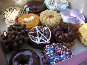 Our Voodoo dozen included cocopuffs, fruit loops, tang, grape koolaid, maple bacon bar, and a lot of other delicious donuts.