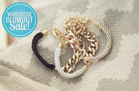 Rope and metal bracelets in black and silver.