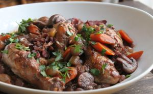 My chicken coq au vin used whole chicken legs that I split, button mushrooms, carrots, pearl onions, 1/2 a bottle of wine, and fresh herbs.  I served it over chewy egg noodles to soak up the wonderful gravy.