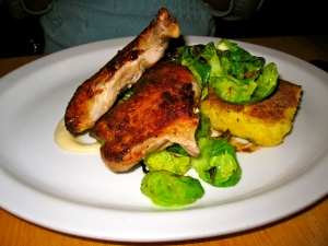 I ordered off their regular menu the roasted Draper Valley chicken with a pear and goat cheese polenta cake, brussels, and bacon vinaigrette.  One complaint...too much bacon for me.