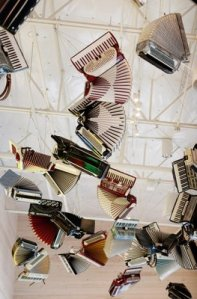 Accordions hanging from the ceiling.