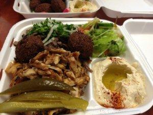 Really good falafel, shwarama, hummus, med salad, pickles, and pita on the side.