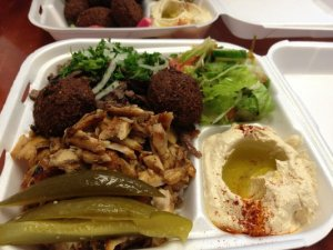 Really good falafel, shwarama, hummus, med salad, pickles, and pita on the side.