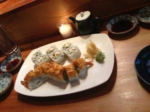 Moshi Moshi 2.0 roll (Snow crab, scallops, mayo, cucumber, shiso, topped with  seared Hokkaido scallops, scallions & lemon, ponzu, momiji) and the Seattle roll (Wild salmon, cucumber, avocado & tobiko)