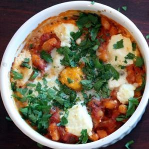 Ramekin + leftover baked beans + egg + chopped parsley + 350 degree oven for 10 minutes = delicious and soft dinner.