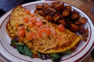 Farmers market omelette with home fries and a side of fruit at Magill's Restaurant in the Tri-Cities.
