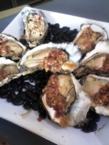 Grilled oysters with bacon topping.