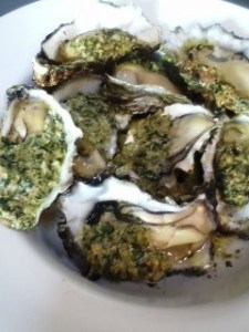 Grilled oysters with herby topping.