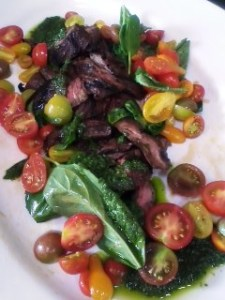 Grilled steak with heirloom tomatoes and salsa verde.