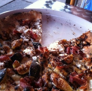 Best pizza ever with olive oil perfect crust, prosciutto, goat cheese, rosemary, figs, and balsamic reduction.