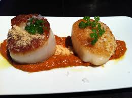 Scallops with almond romesco sauce.