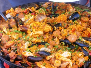 A huge pan of paella.