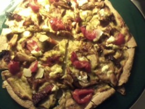 Chanterelle mushrooms, sun-dried tomatoes, cherry tomatoes, goat cheese, and chicken.