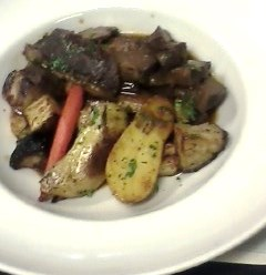 Braised Short Ribs, Mushroom Demi, Glazed Root Vegetables, Fried Leeks.  Pretty than the picture suggests.