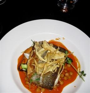 Crispy potato-wrapped True Cod with Mediterranean mussels, Swiss chard, chraimeh & golden raisin relish