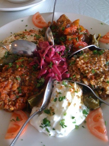 Turkish mezze platter of moussaka, roasted eggplant in tahini and yogurt, beet hummus, and a couscous salad plus fresh pita.  Yum!!