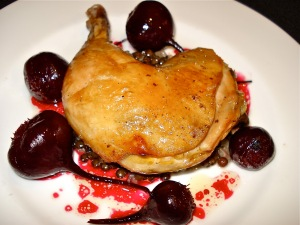 Roasted chicken on a bed of lentil pilaf and roasted beets.