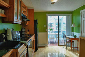 Our kitchen with sunroom in the background.