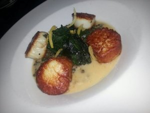 Seared scallops, pureed lentils, sauteed spinach, cinnamon vinaigrette.