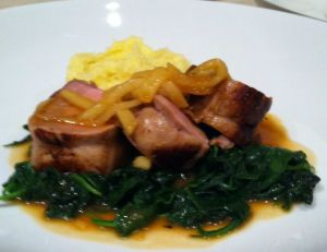 Brined and cider glazed pork loin on a bed of pancetta and garlic spinach and topped with brandied apples.