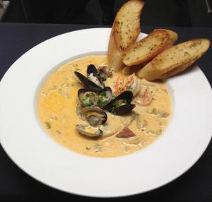 Bryan's really amazing seafood chowder in a lobster bisque broth.