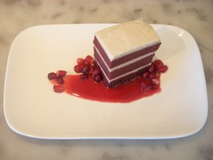 Beet red velvet cake with cream cheese frosting, pomegranate, and liquory syrup from Lecosho.