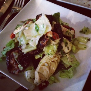 Half order of the verdi salad with artichokes, red peppers, eggplant, onion, and feta.