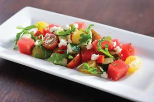 Refreshing arugula, watermelon and feta salad (also with tomatoes, red onion, and cucumber)