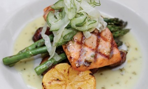My absolutely delicious Pacific grilled salmon...at a bar...for $15.  Great potatoes, asparagus, cucumber relish salad and lemony sauce!