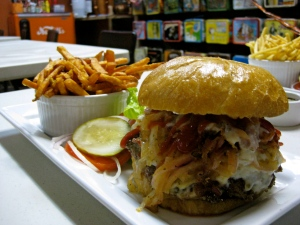 My awesome Tear Jerker burger and sweet potato fries before heading out their fire pit to eat.  Pepperjack cheese, sauteed onions, jalapenos, habenero mayo, Satan's tears ketchup!!!
