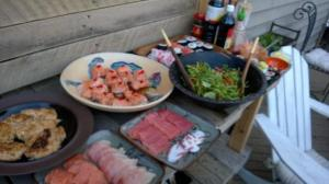 Look at this spread:  sashimi, baked salmon with sriracha aioli, ginger salad...
