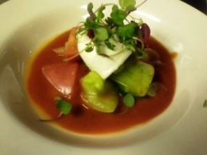 First course of a silky gazpacho with awesome heirloom tomatoes, burrata cheese, and microarugula.