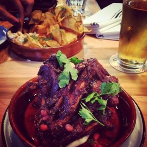 Holy spiced duck wings with yogurt sauce and pomegranate.
