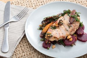 Seared pork chops with beet, carrot and hazelnut salad.