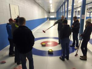 My lane learning the rules of curling.