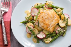 Seared cod with a lemon mustard sauce and spring vegetables.