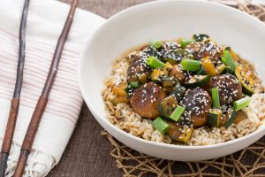 Blue Apron Asian chicken meatballs with zucchini and brown rice.