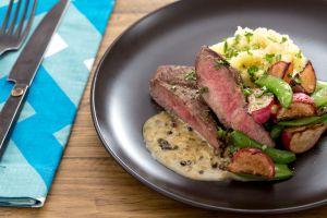 Seared Sirloin steaks with mash potatoes and snap pea saute.
