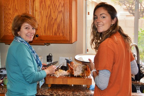Mom and I cutting the turkey
