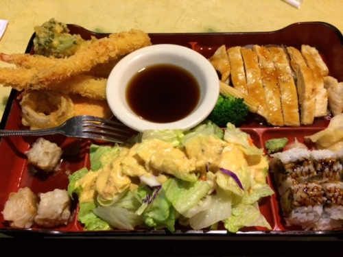 """Japanese bento box with tempura shrimp and vegetable, pork shumai, chicken teriyaki, salad, and eel and avocado roll along with a miso soup that is not shown. Can you say """"huge""""?!?!"""