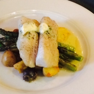 Baked cod with herbed butter, chorizo potato hash and asparagus.