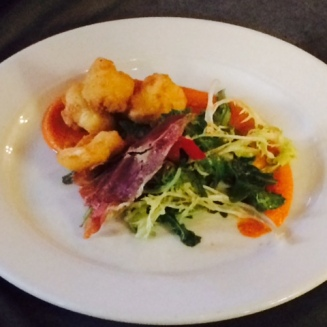 Fried Beechers cheese curd, prosciutto and salad.