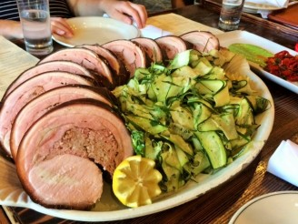 Rolled and stuffed porchetta, shaved zucchini salad.