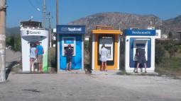 Funniest picture ever of five tourists using the ATM off of the bus