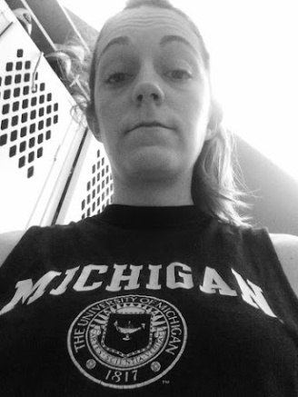 No smiling in the locker room but feeling good post workout and with my Michigan Alumni shirt on