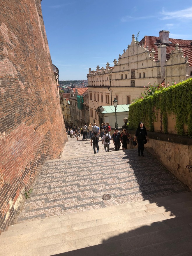 Descending the steps from the castle