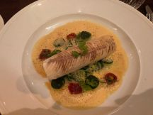 Trout rolled with prawns, zucchini noodles and lobster broth